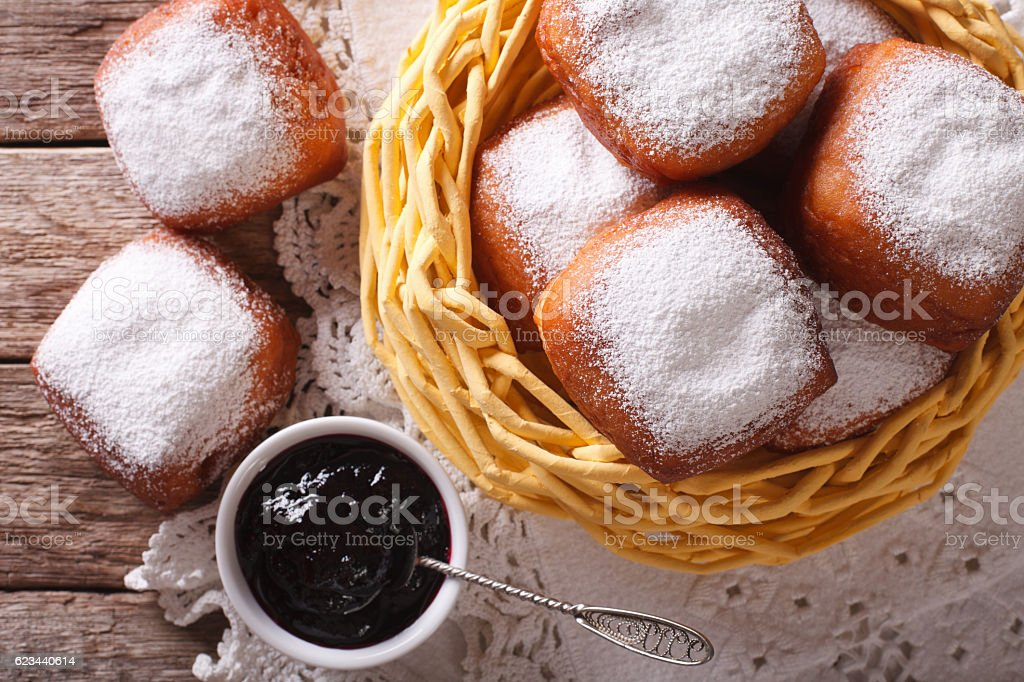 New Orleans beignets in a basket and jam closeup. Horizontal stock photo
