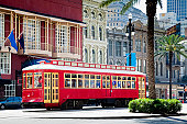 istock New Orleans Bright Red Streetcar Traveling Amid Palms and Flags 157614008
