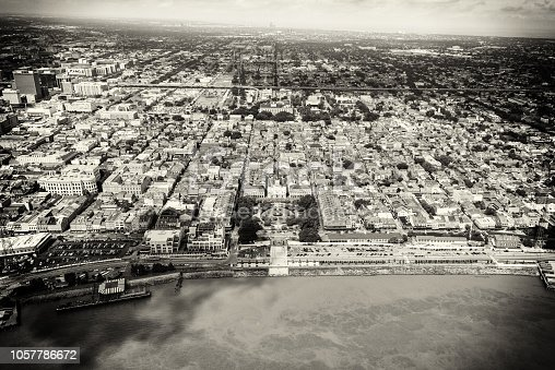 The famed French Quater of New Orleans, Louisiana in black and white and toned in sepia for a retro effect shot from an altitude of about 1000 feet featuring Jackson Square located in the center of the image.
