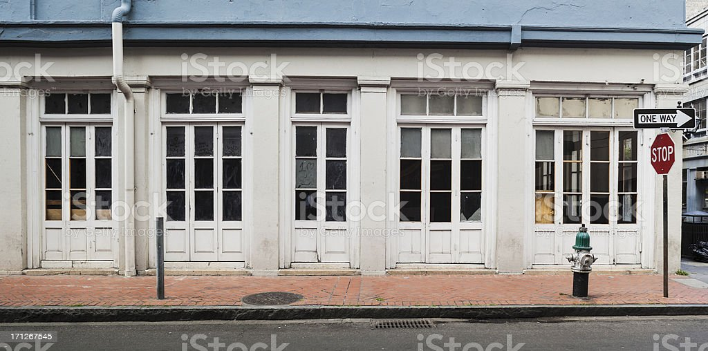 New Orleans French Quarter White Building with Brick Sidewalk stock photo