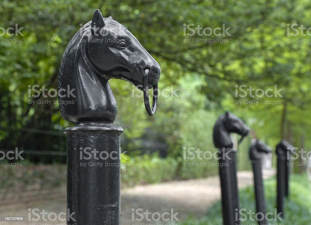 New Orleans Hitching Posts With Horse Heads in Garden District stock photo