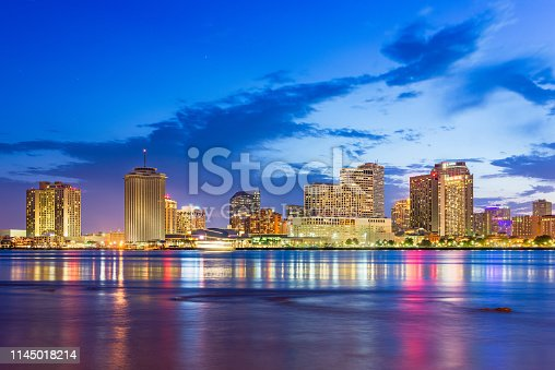 New Orleans, Louisiana, USA downtown city skyline on the Mississippi River at dusk.