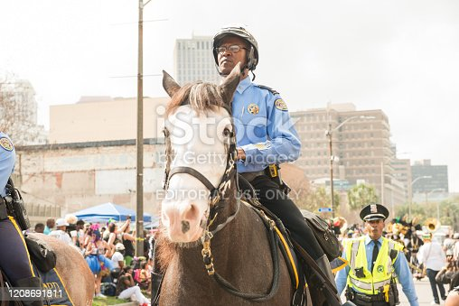 In New Orleans, United States police on horseback and foot make way for a parade in the street for Mardi Gras.