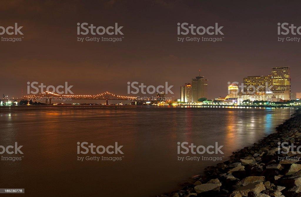 New Orleans skyline and bridge at night stock photo