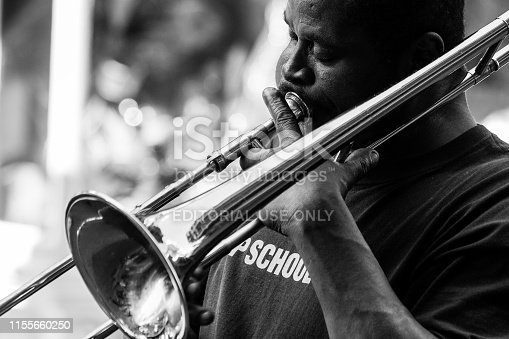 New Orleans, USA - Jan 19 2013: Local jazz band performs in the streets for money in New Orleans, USA