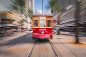 New Orleans, USA - October 05, 2016 : Famous streetcars of New Orleans driving in Canal Street during a bright spring day.   Twist effect.