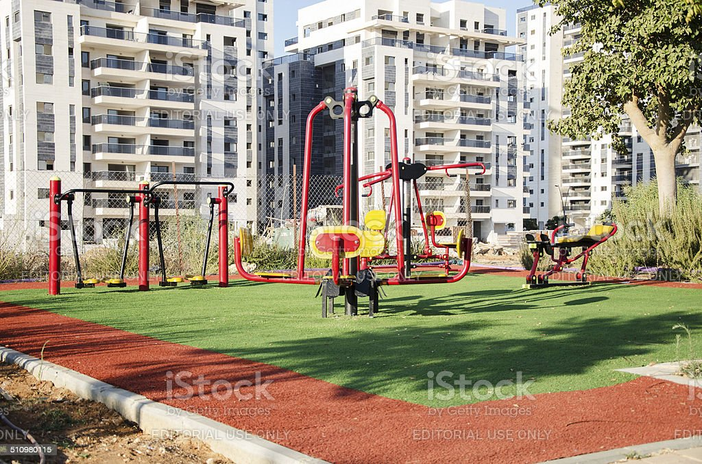 New outdoor fitness station in residential area stock photo