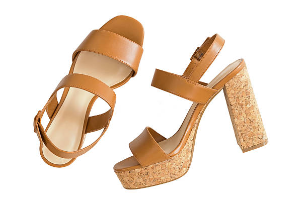 New pair of stylish brown high heels with cork soles stock photo