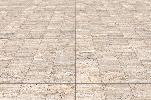New paving made with italian travertine stone blocks of rectangular shape in a pedestrian zone