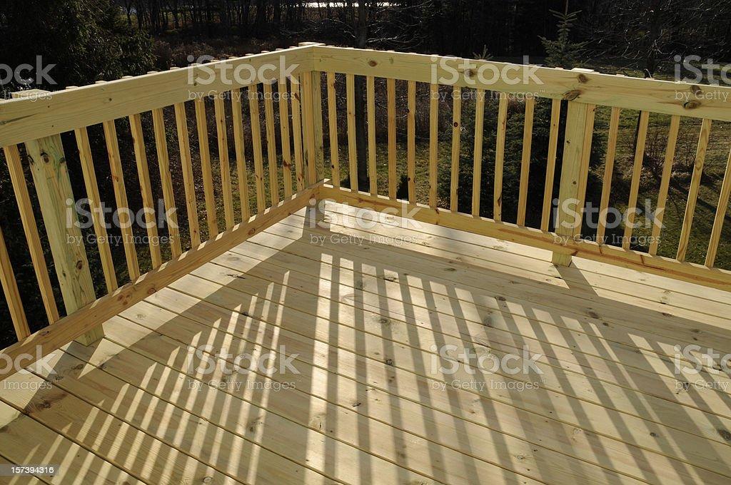 New Pine Wood Stock Lumber Patio Deck Building, Railing, Shadow royalty-free stock photo