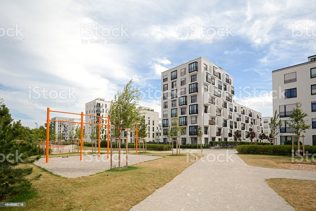 New playground and modern residential buildings stock photo