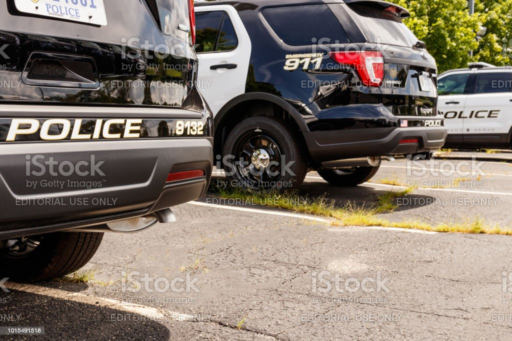 New police cars waiting for calls at the station III stock photo