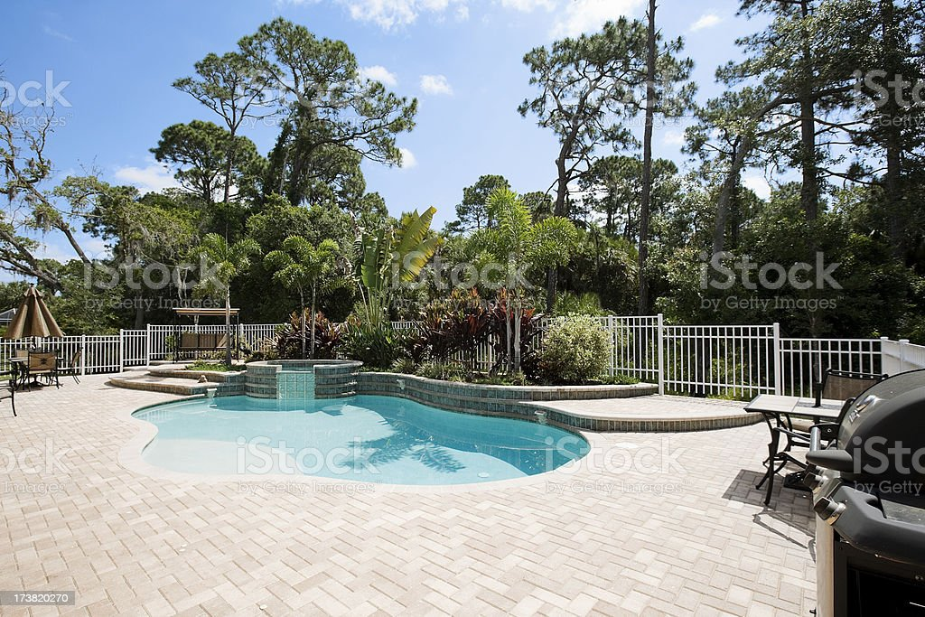 New Pool hot tub showcase home back yard private patio royalty-free stock photo