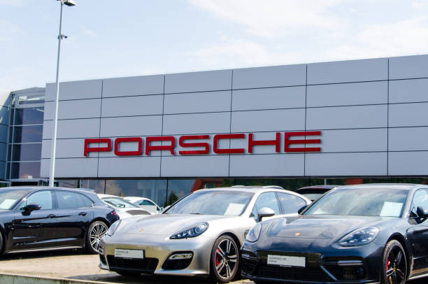 New PORSCHE in the Car showroom. Soest, Germany - August 2, 2019: New PORSCHE in the Car showroom. porsche stock pictures, royalty-free photos & images
