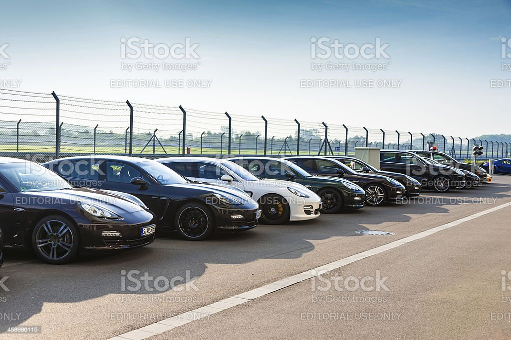 New Porsche Panamera and Cayenne Sports Cars in a Row royalty-free stock photo