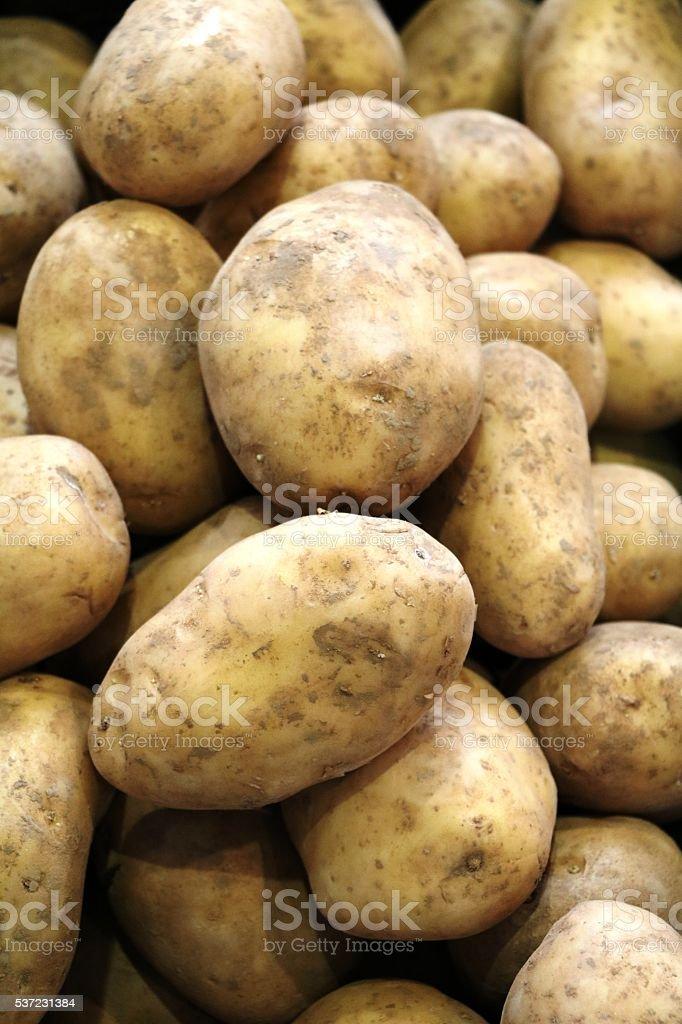 New potatoes at the weekly market stock photo