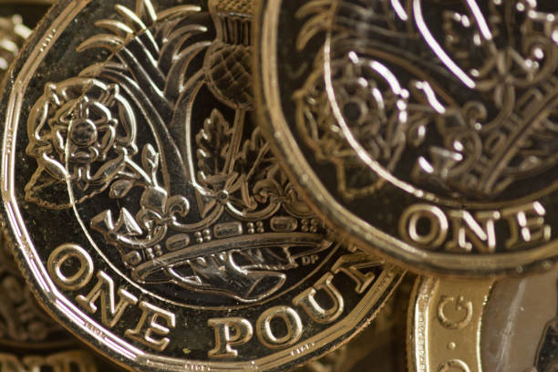 New pound coin released 2017 Close up of the new UK pound coin released into circulation 30 Mar 2017. british currency stock pictures, royalty-free photos & images
