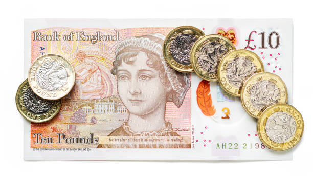 new pound coins and new uk ten pound note - whiteway money stock photos and pictures