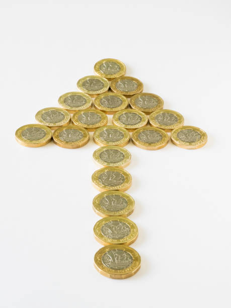 New pound coins forming an arrow shape picture id917873998?b=1&k=6&m=917873998&s=612x612&w=0&h=qhjpa0z0epdzun50x 5wc3bxq641zmeyk8ox mubku0=