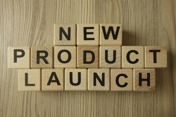 New product launch text from wooden blocks stock photo