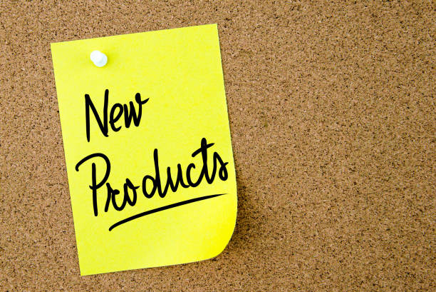 New Products text written on yellow paper note – Foto