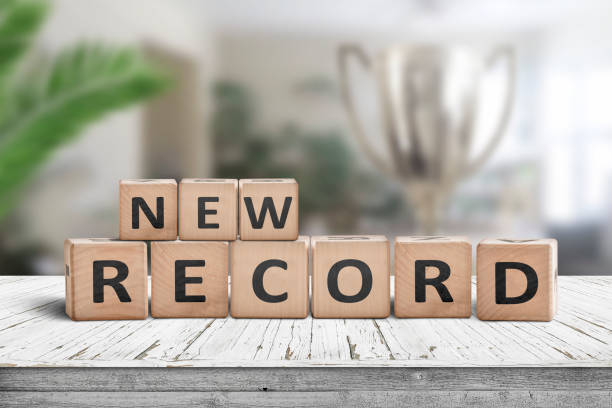 New record sign on a wooden table in a bright room stock photo