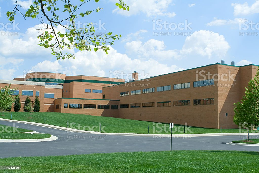 New Red Brick Office Building Grass Intersection Road Suburban Maryland stock photo