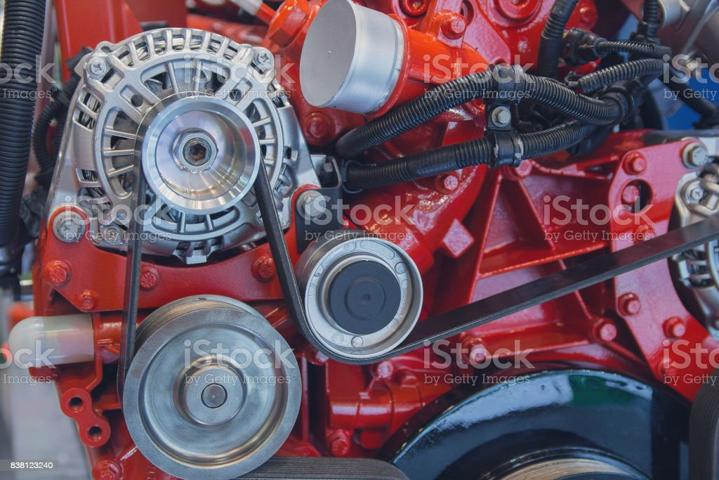 New red internal combustion engine close-up. Industry stock photo