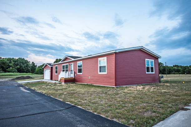 New Red Manufactured Home New manufactured home in a new community.  The window on the far right on the front shows a reflection of the sunset at the top. manufactured housing stock pictures, royalty-free photos & images