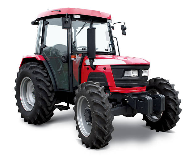 New red tractor with cabin stock photo