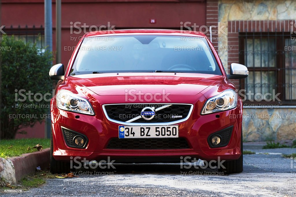 New Red Volvo at The Istanbul Streets Istanbul, Turkey - October 16, 2016: New Red Volvo at the Istanbul Streets in a sunny day in front of houses in a district. There is nobody in the car. Car Stock Photo