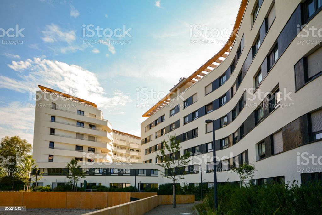 New residential and commercial building with modern facade in the city stock photo