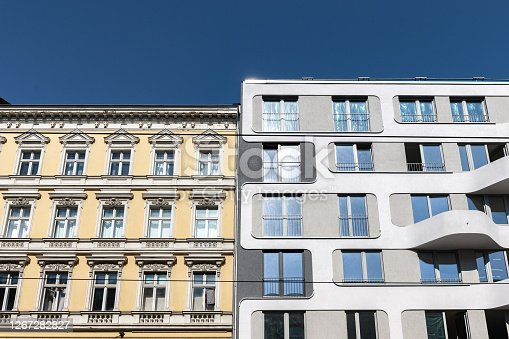 istock new residential building beside historic apartment house in berlin 1267282827