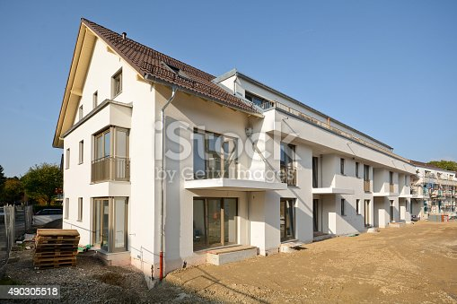 istock New residential buildings with outdoor facilities, Construction work near completion 490305518
