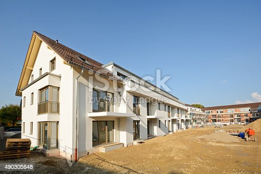 istock New residential buildings with outdoor facilities, Construction work near completion 490305648