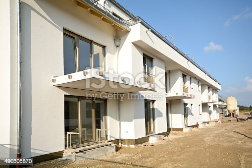 istock New residential buildings with outdoor facilities, Construction work near completion 490305870