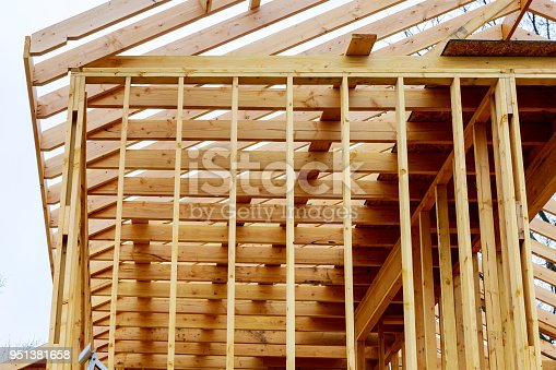 534196421 istock photo New residential construction home framing with roof view 951381658