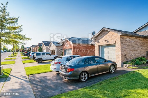 New residential neighborhood with row of detached houses in London Ontario Canada on a sunny day.