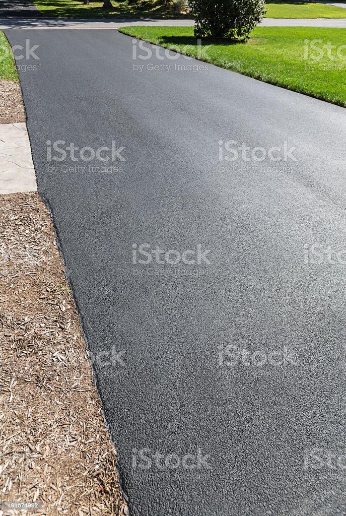 New Residential Driveway Blacktop Asphalt Resealing stock photo