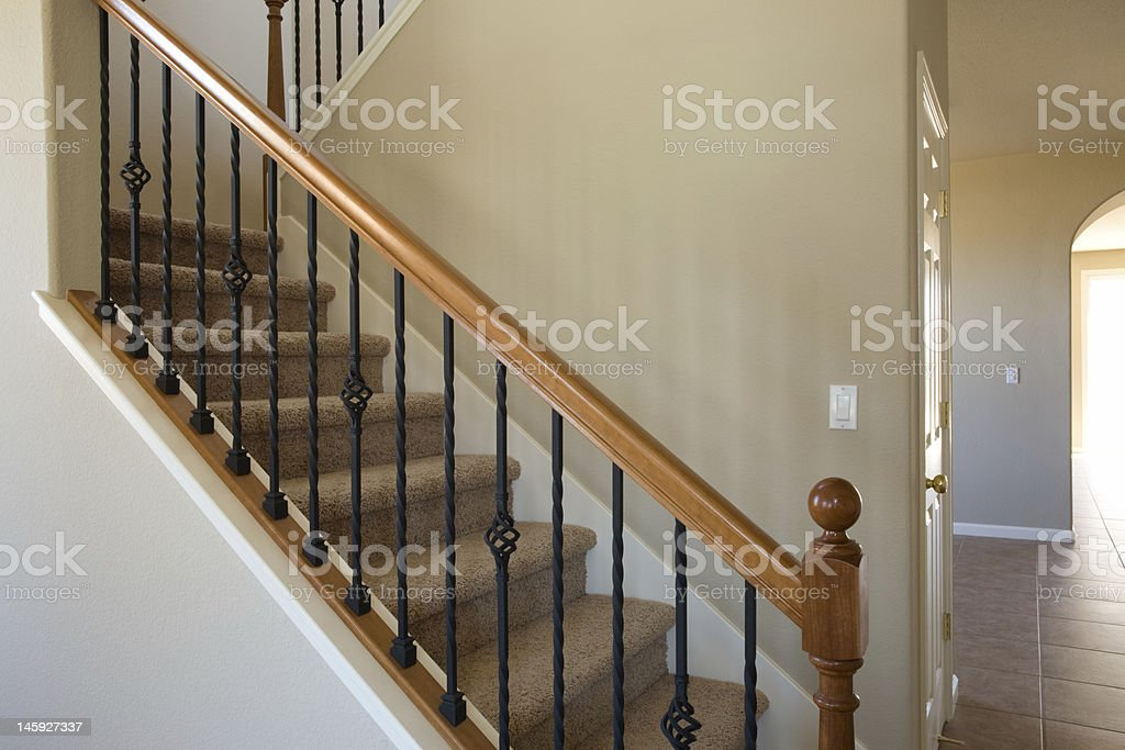New residential home carpet stairs and railing. stock photo
