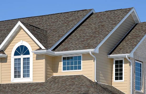 New Residential House; Architectural Asphalt Shingle Roof, Vinyl Siding, Gables stock photo
