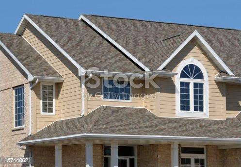 istock New Residential House; Architectural Asphalt Shingle Roof, Vinyl Siding 157440621
