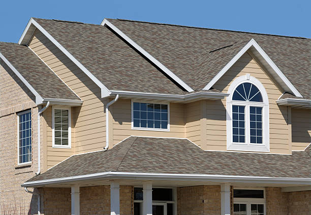 New Residential House; Architectural Asphalt Shingle Roof, Vinyl Siding stock photo