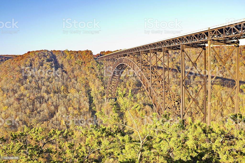 New River Gorge Single-Span Arch Bridge in Autumn Sunrise stock photo