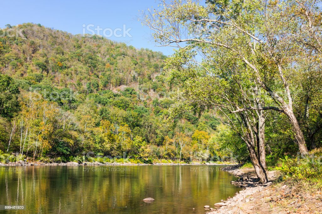 New River Gorge water river lake during autumn golden orange foliage in fall by Grandview with peaceful calm tranquil day stock photo