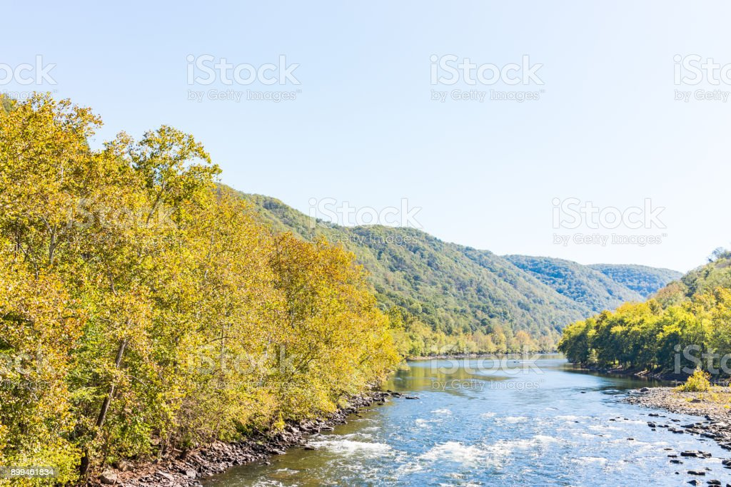 New River Gorge wide canyon water aerial view overlook during autumn golden orange foliage in fall by Thurmond, West Virginia stock photo