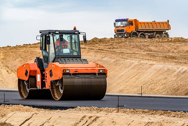 New road construction Road roller building the new asphalt road compactor stock pictures, royalty-free photos & images
