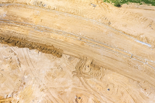 new road under construction. industrial background. aerial view