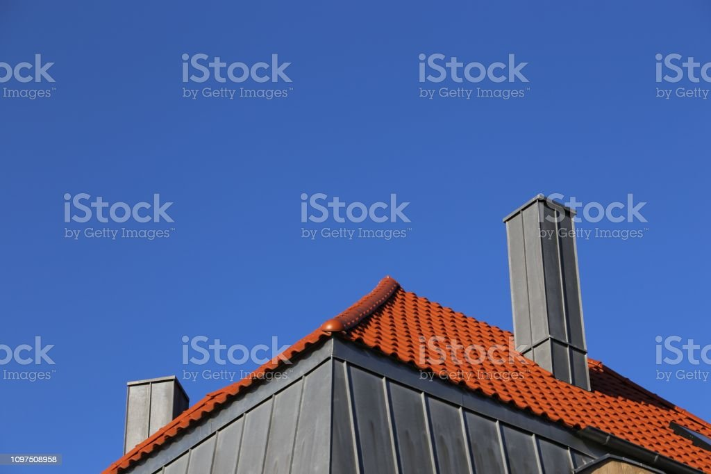 New Roof With Chimney Made Of Stainless Steel Stock Photo