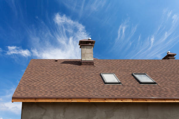 New roof with skylight, asphalt roofing (shingles) and chimney. Roof with mansard windows . stock photo